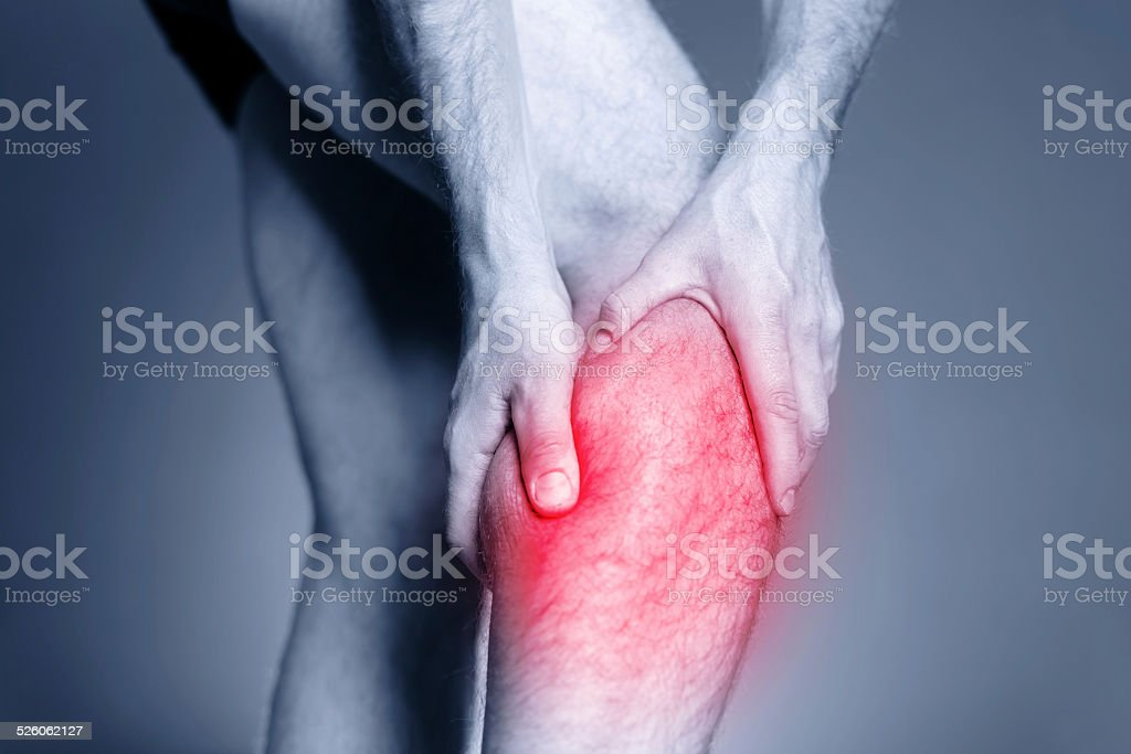 Calf leg pain, muscle injury stock photo