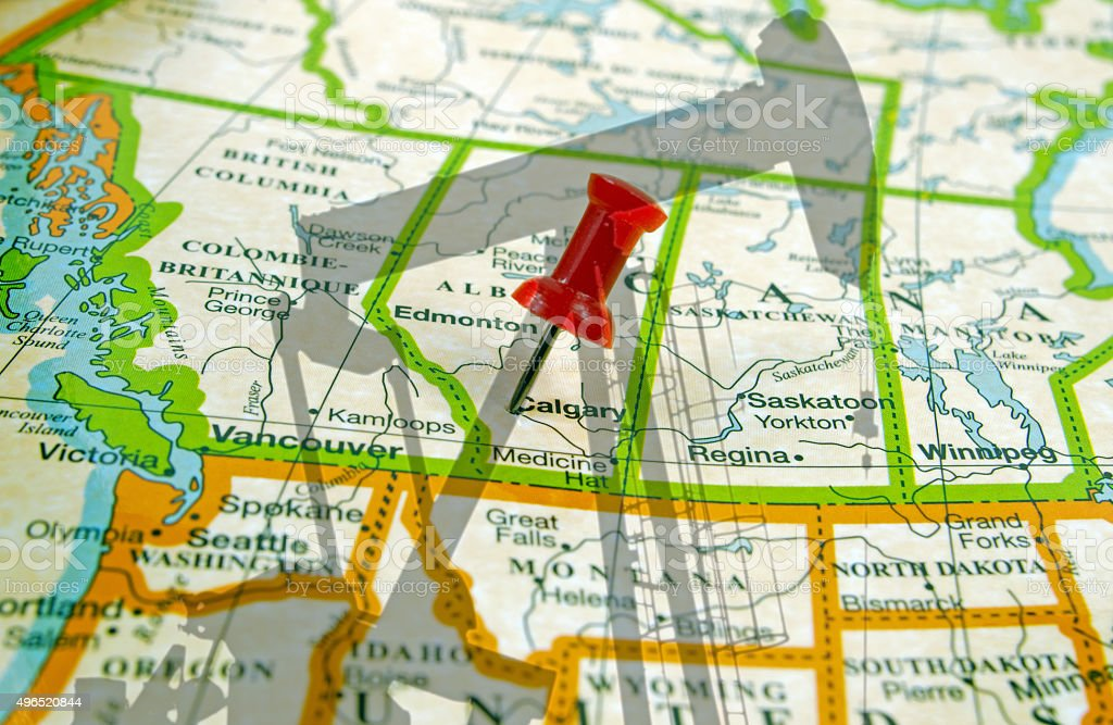 Calgary on map and shadow of a oil well pump stock photo