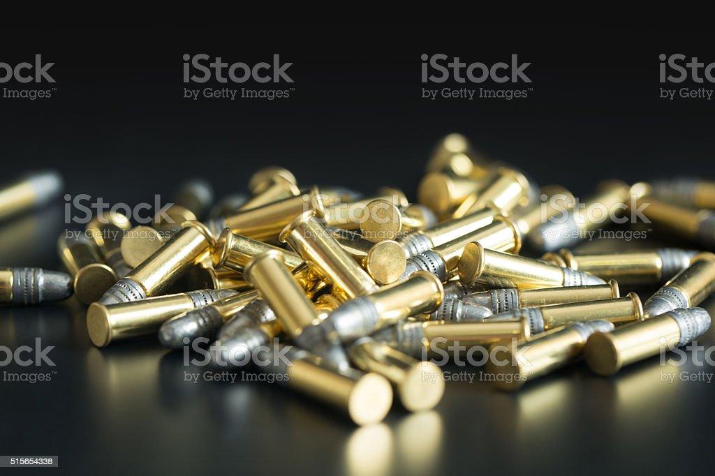 .22 Caliber Bullets on Black Background stock photo