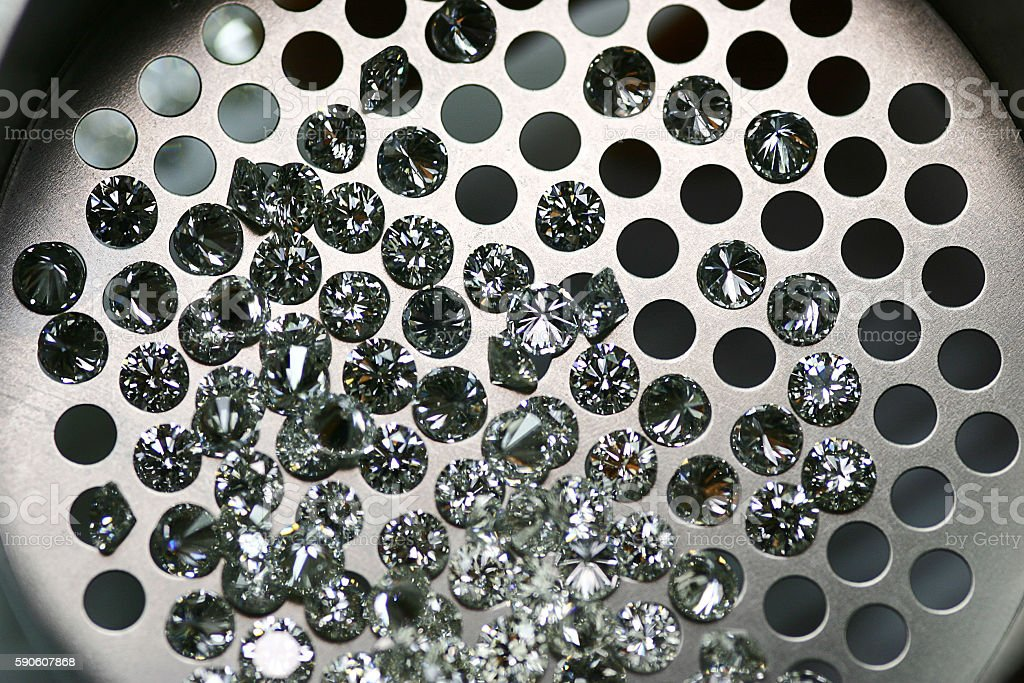Calibrated diamonds through the sieve stock photo
