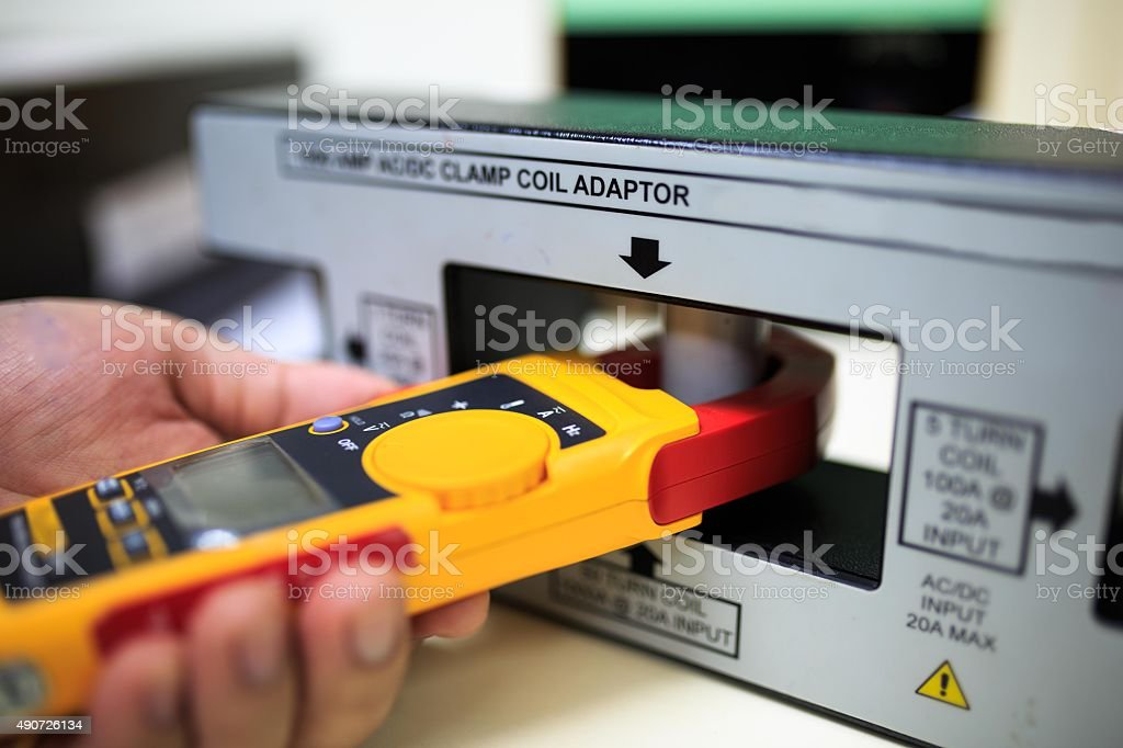 Calibration clamp meter with clamp coil adaptor stock photo