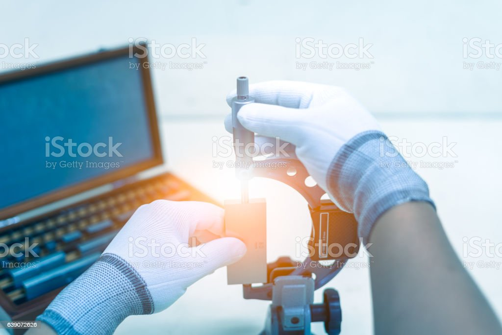 Calibration outside micrometer in laboratory. stock photo
