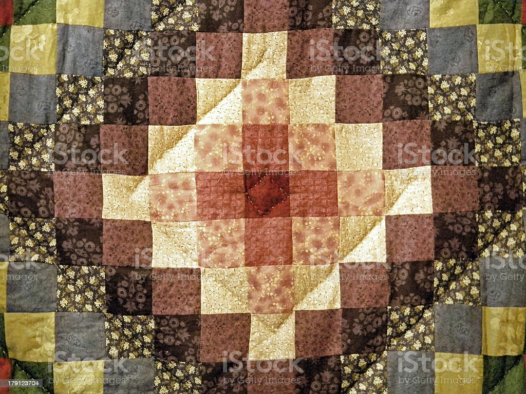 calico brown quilt square stock photo