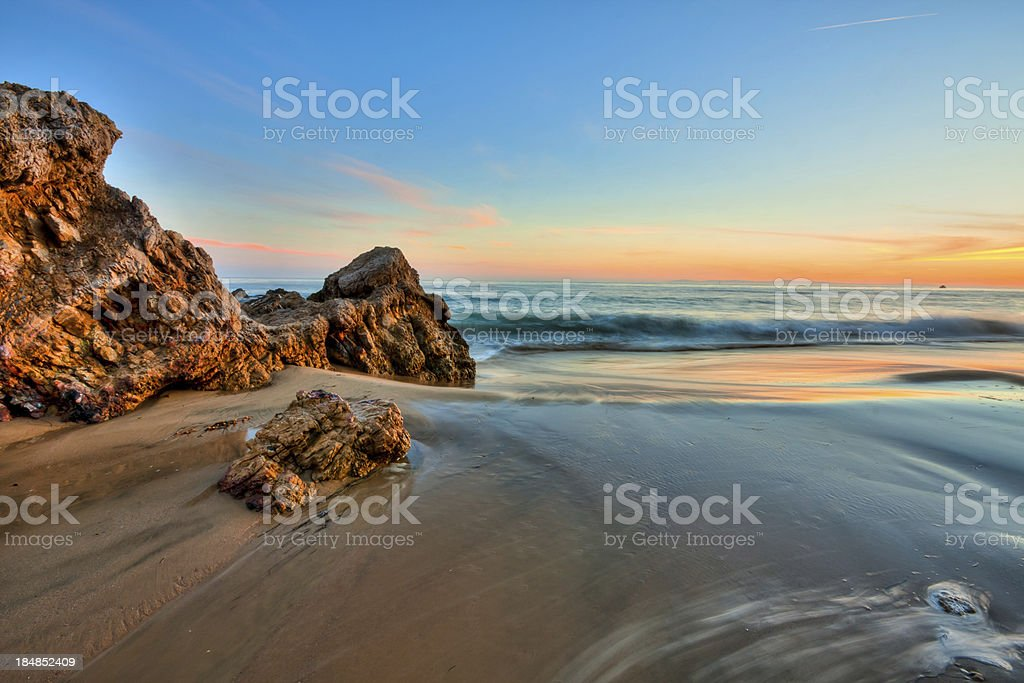 california beach in sunset stock photo