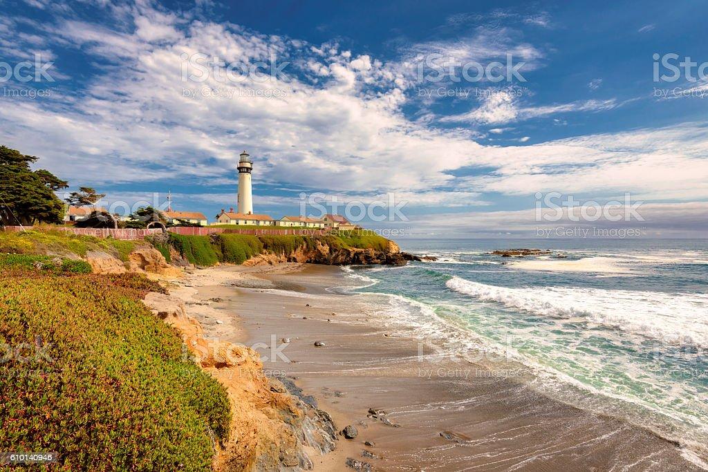 California beach with lighthouse stock photo