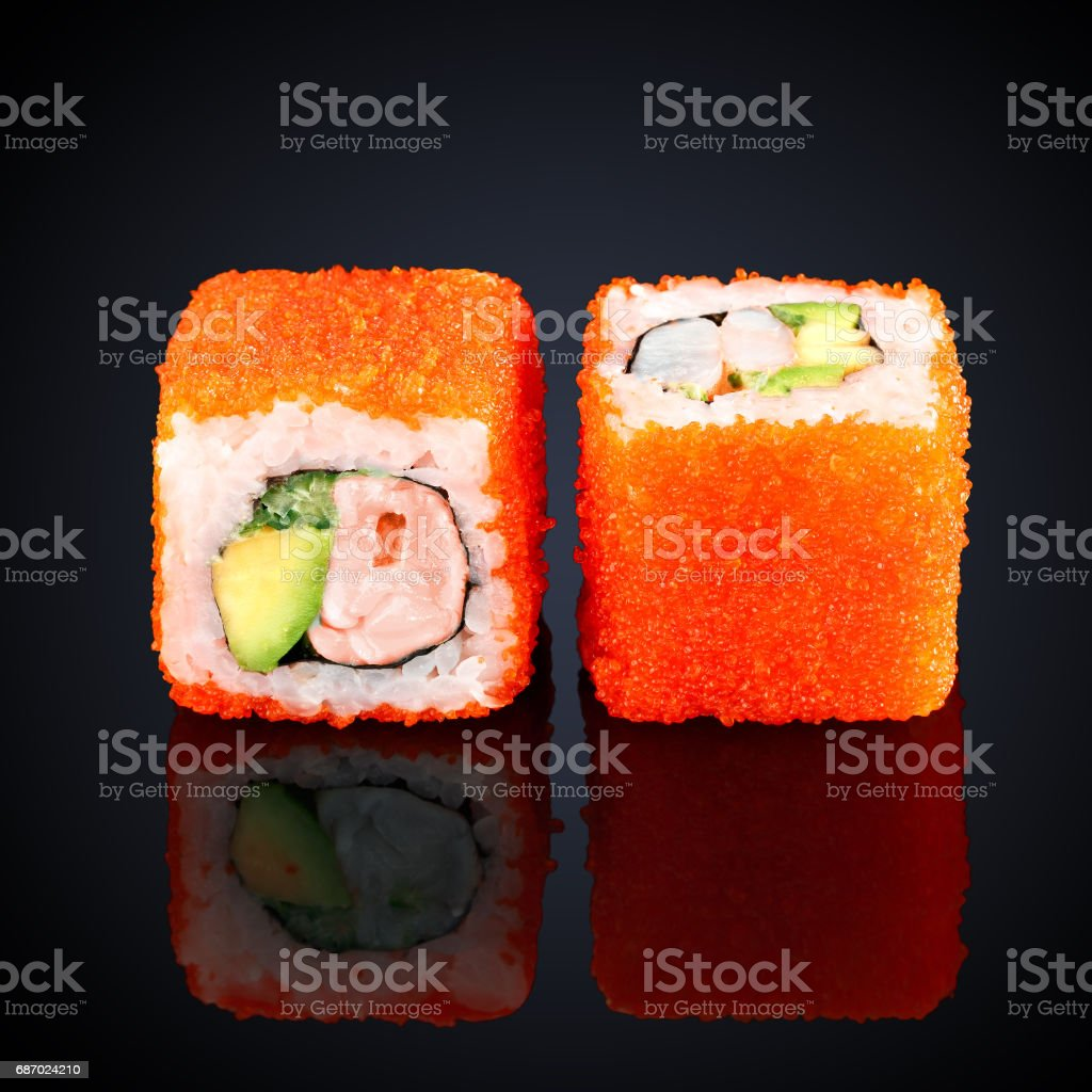 California roll with salmon, avocado and cucumber stock photo