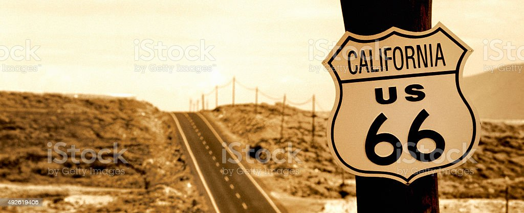 California route 66 road sign on wooden pole, in sepia stock photo