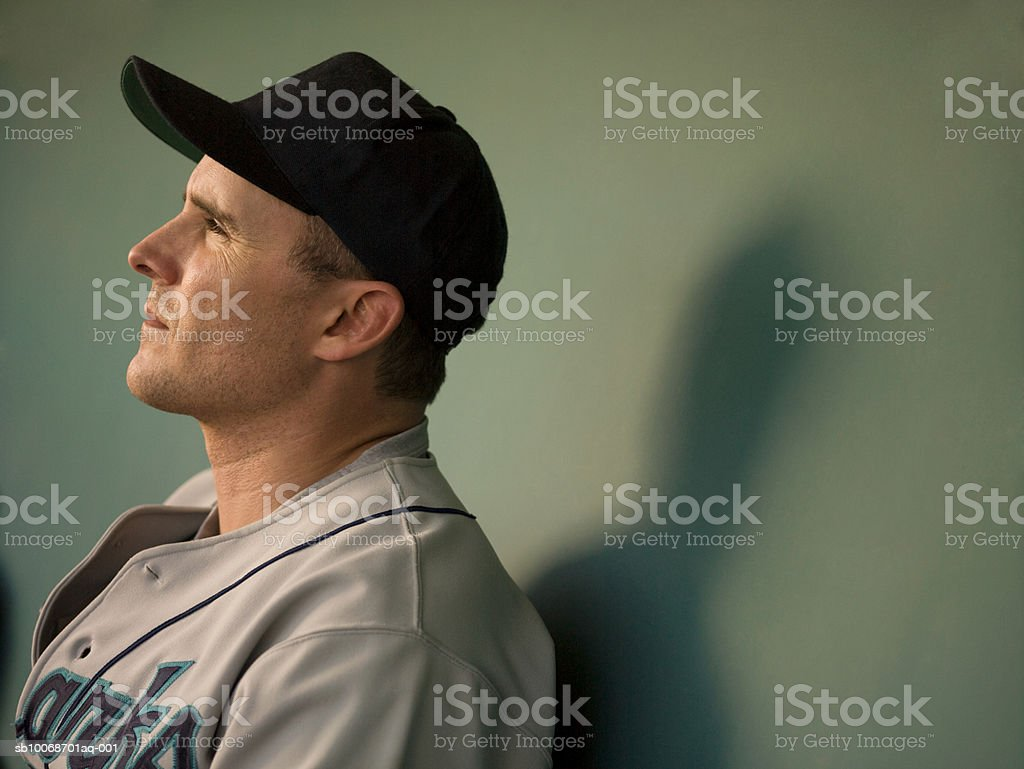 USA, California, San Bernardino, baseball player sitting in dugout stock photo
