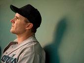 USA, California, San Bernardino, baseball player sitting in dugout