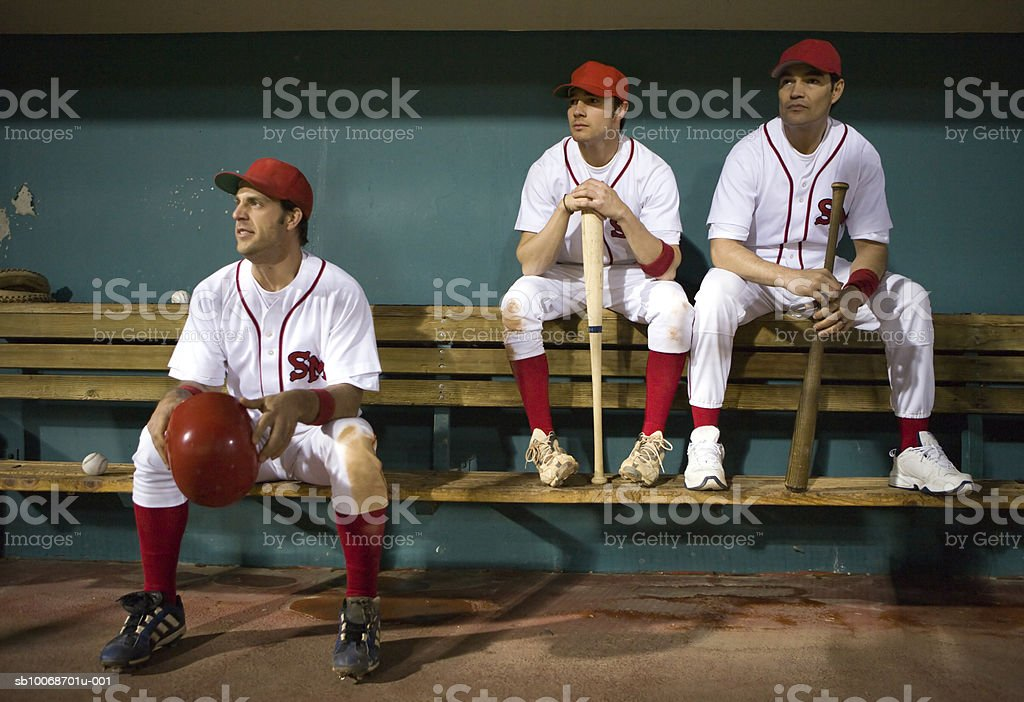 USA, California, San Bernardino, baseball players sitting in dugout stock photo