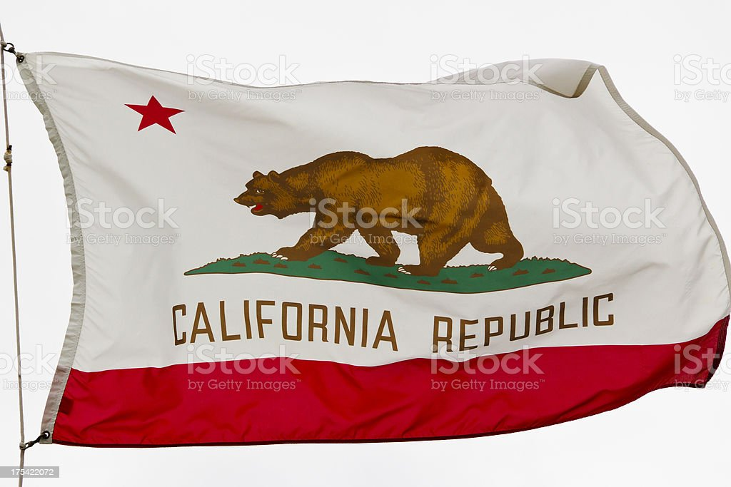 California State Flag Against a White Cloud Sky stock photo