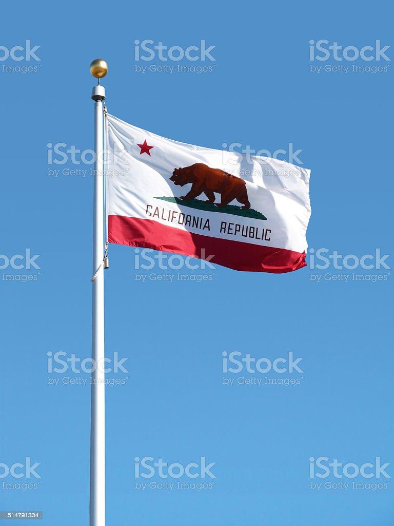 California State Flag Waving on Pole Symbol Blue Sky stock photo