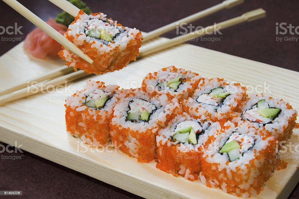 California sushi rolls with chopsticks royalty-free stock photo