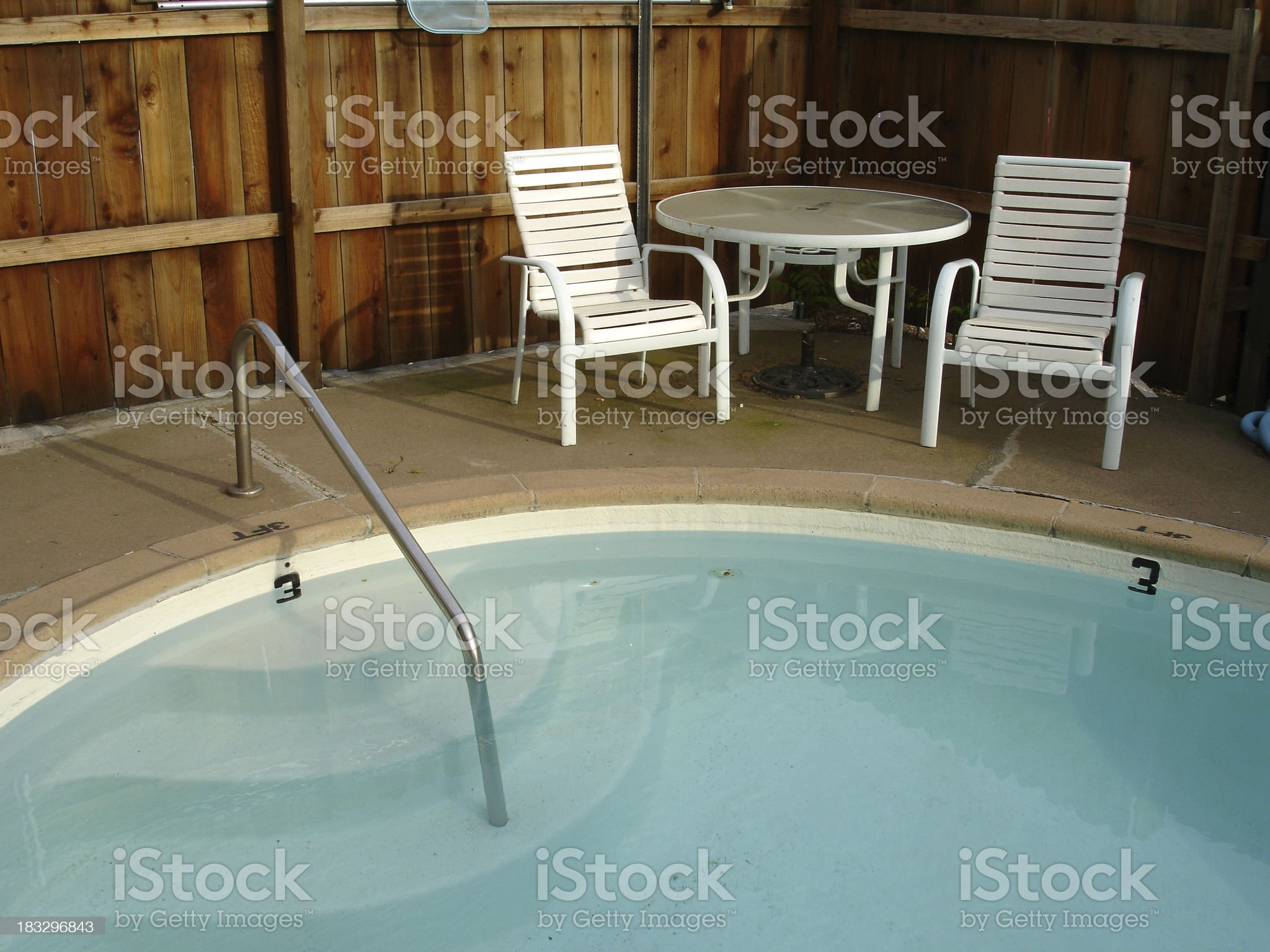 California swimming pool set , steps, table and chairs royalty-free stock photo