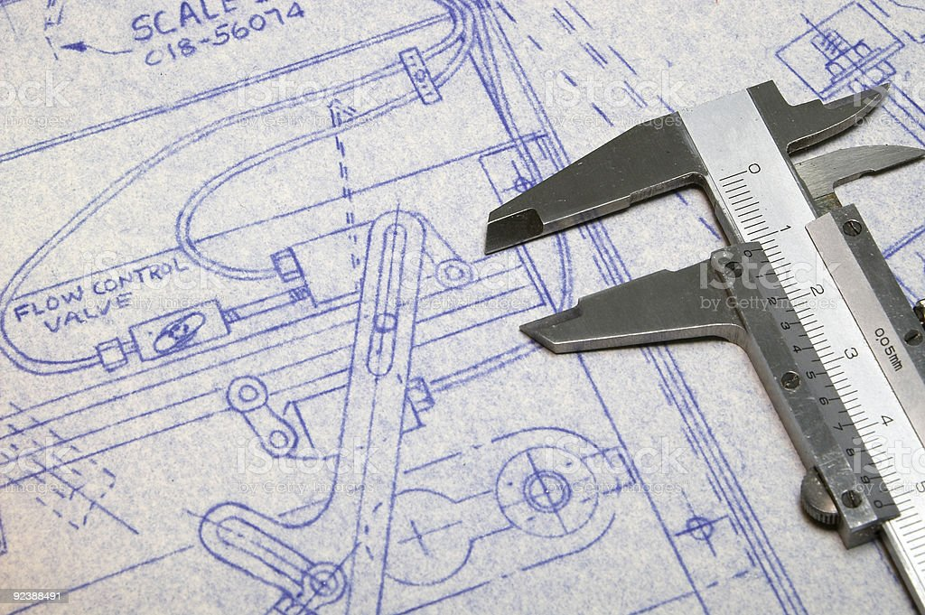 Caliper and blueprint with diagram royalty-free stock photo