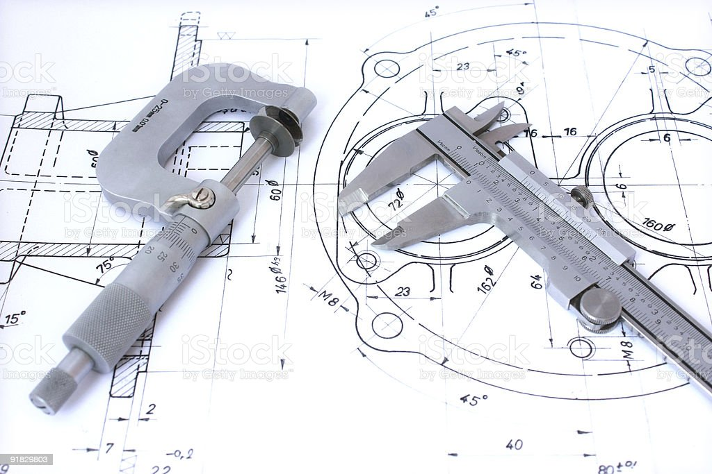 Caliper and micrometer on blueprint stock photo