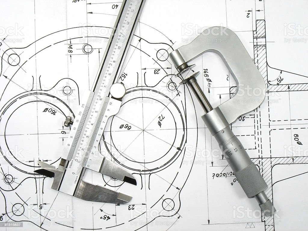 Caliper and micrometer on technical drawing stock photo