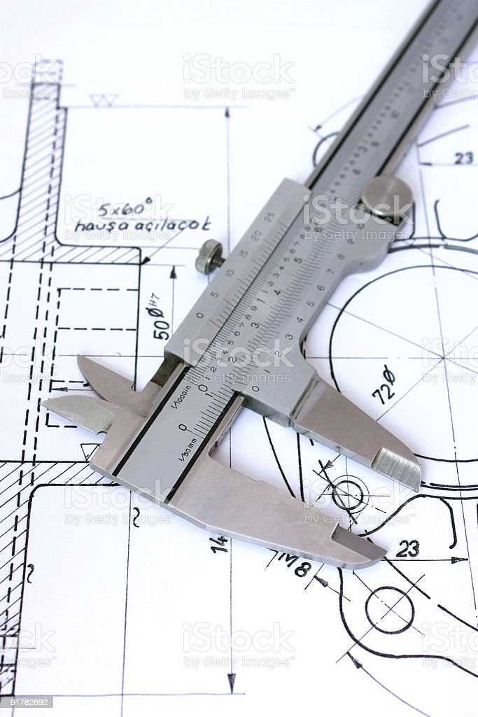 Caliper on blueprint. Vertical royalty-free stock photo