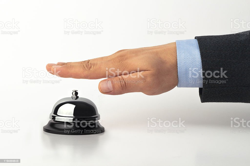 Call bell being pressed by male wanting service royalty-free stock photo