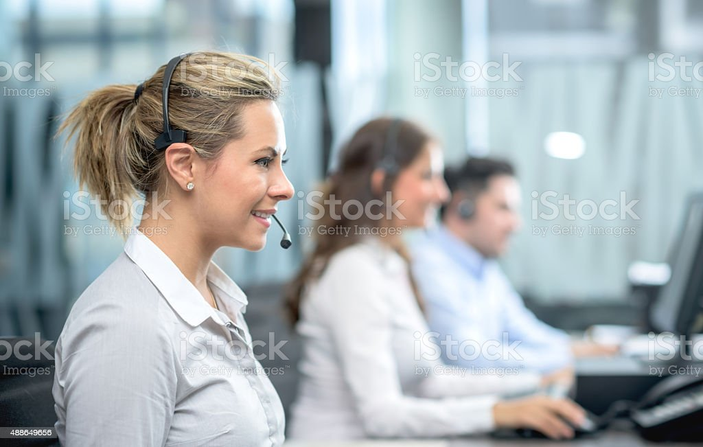 Call center agent working stock photo