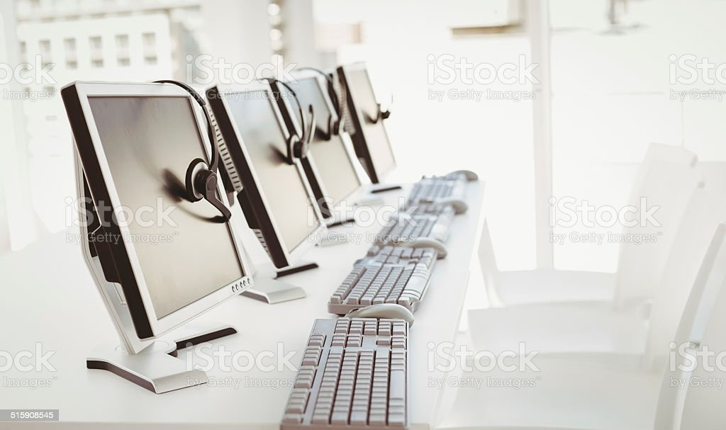 Call center computers and headsets stock photo