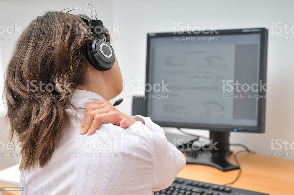 Call center employee with neck pain stock photo