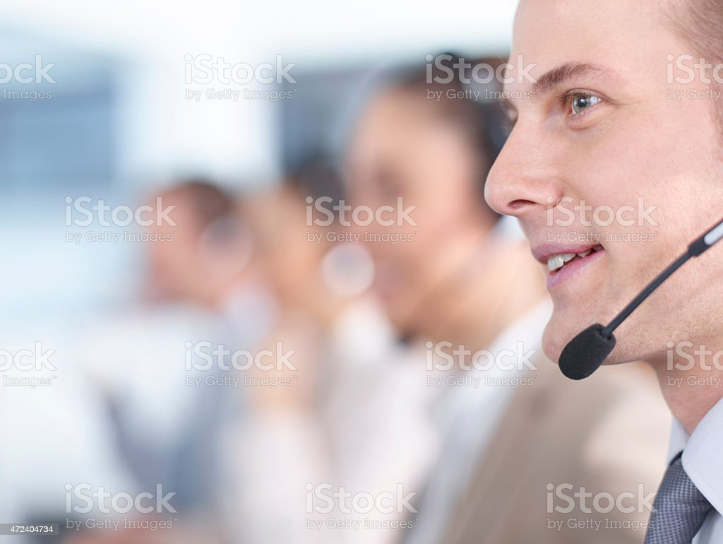 Call center male employees working stock photo