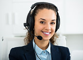 Call center operator talking with client and smiling