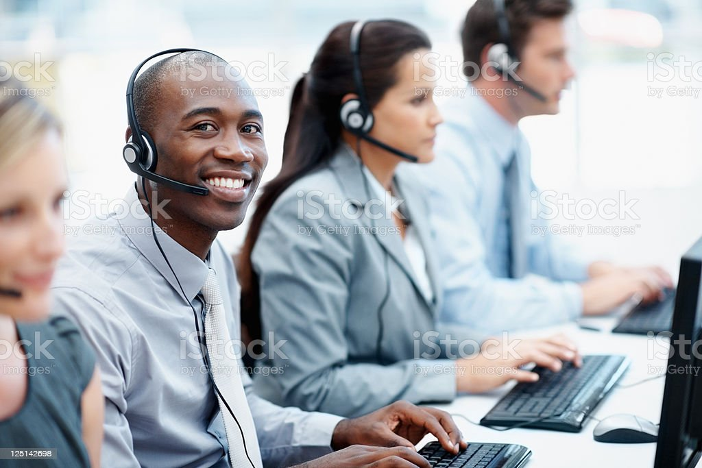 Call center representatives typing in line royalty-free stock photo