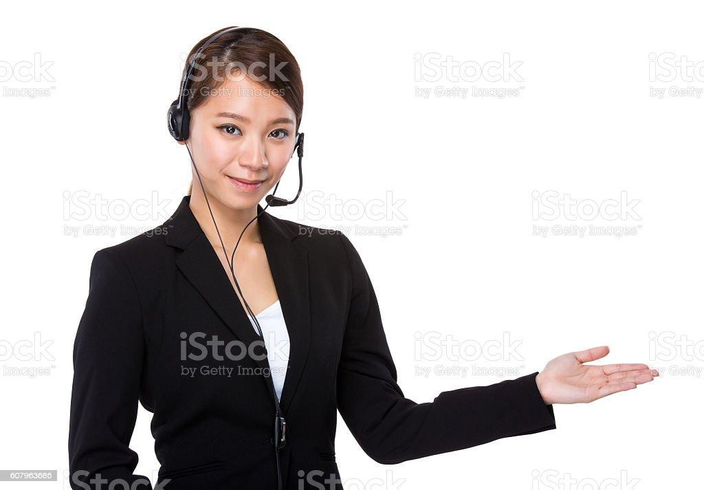 Call centre operator gesturing stock photo