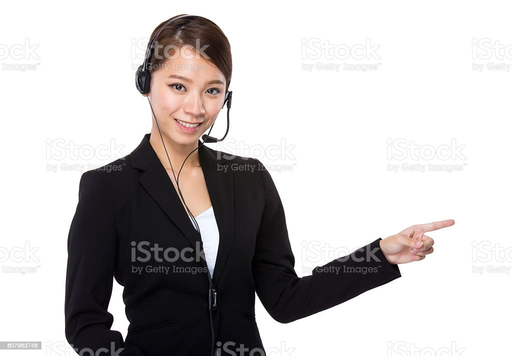 Call centre operator pointing stock photo