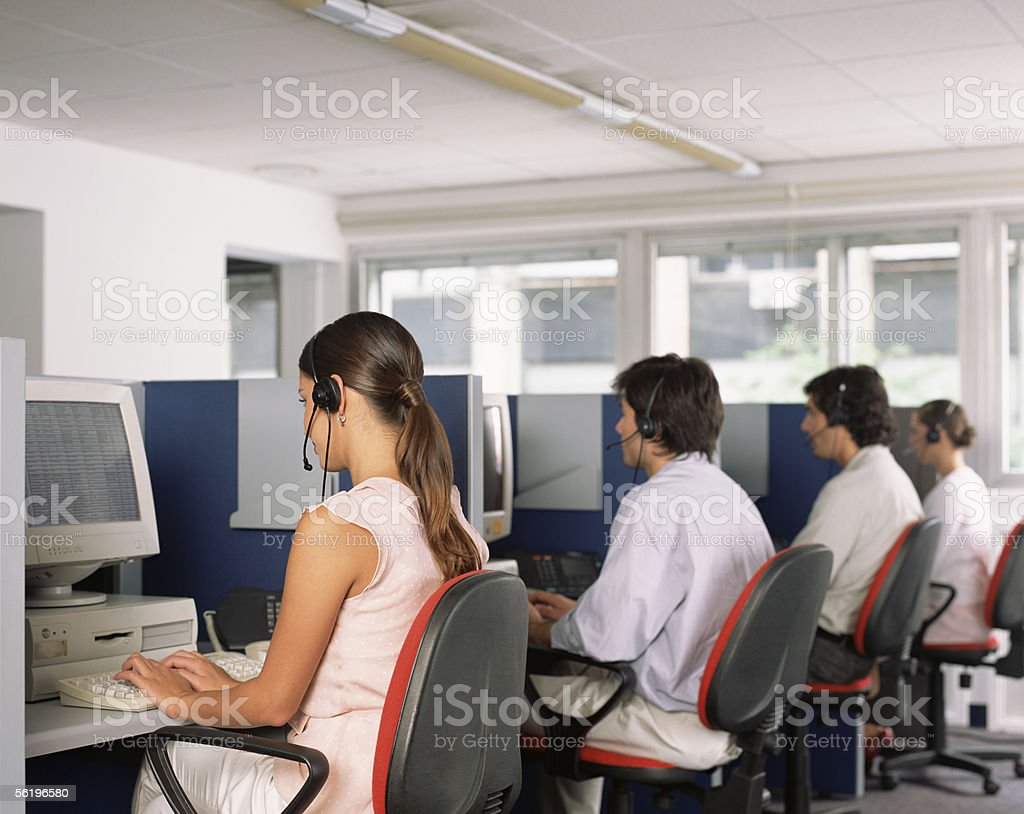 Call centre workers, stock photo