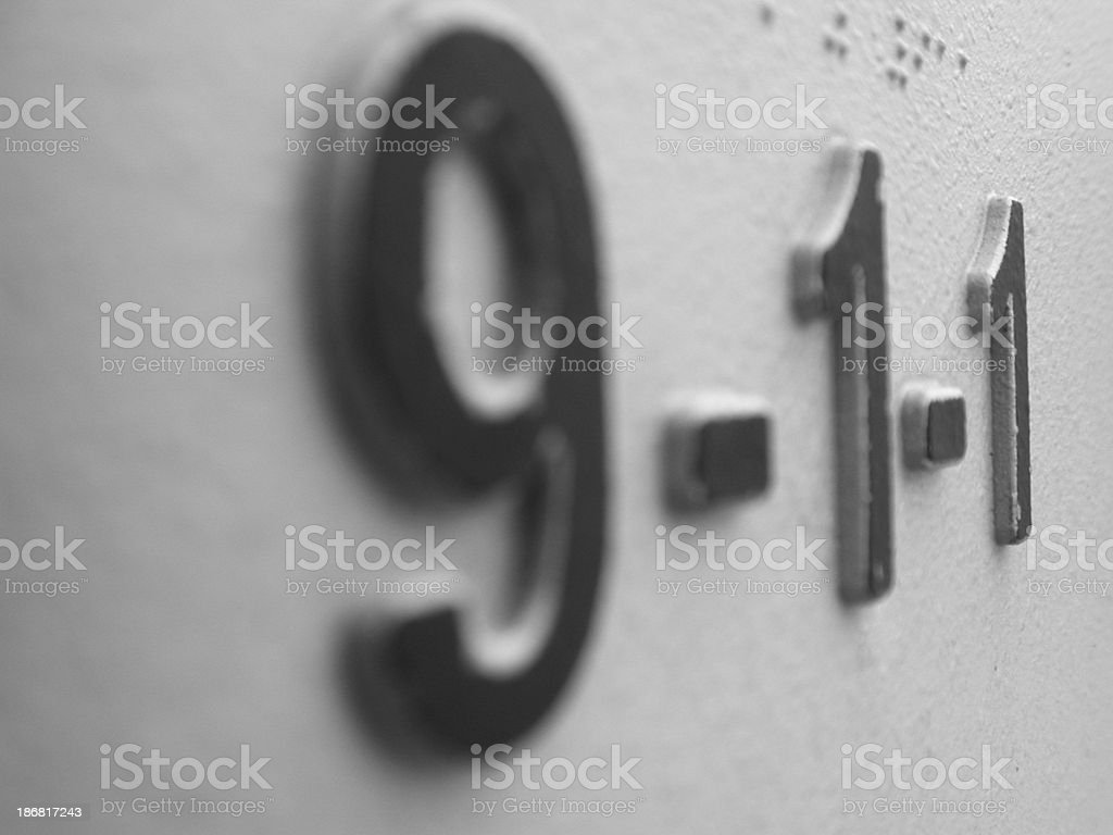 911 call post sign - emergency stock photo