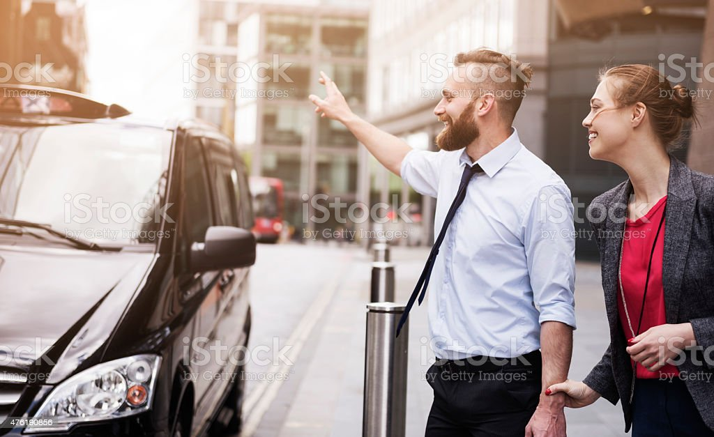 Call the taxi, we can't be late on the meeting stock photo