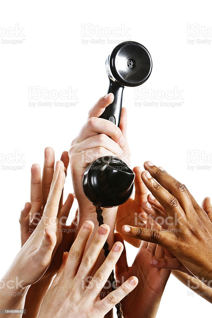 Call they've been expecting: many hands reaching for phone royalty-free stock photo