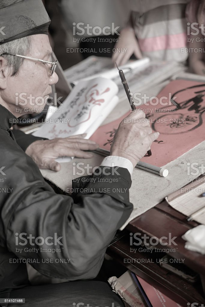 Calligrapher at Temple of Jade Mountain in Hanoi, Vietnam. stock photo