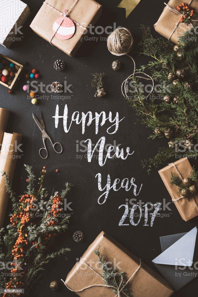Calligraphy Happy New Year chalk written blackboard, flat lay stock photo
