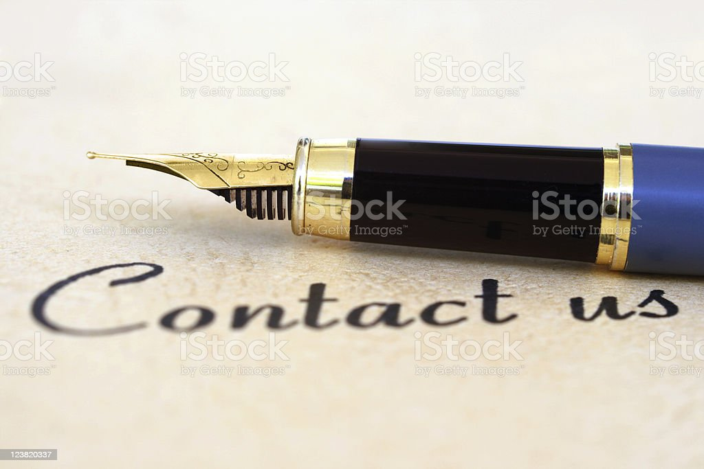 Calligraphy pen above contact us wording royalty-free stock photo