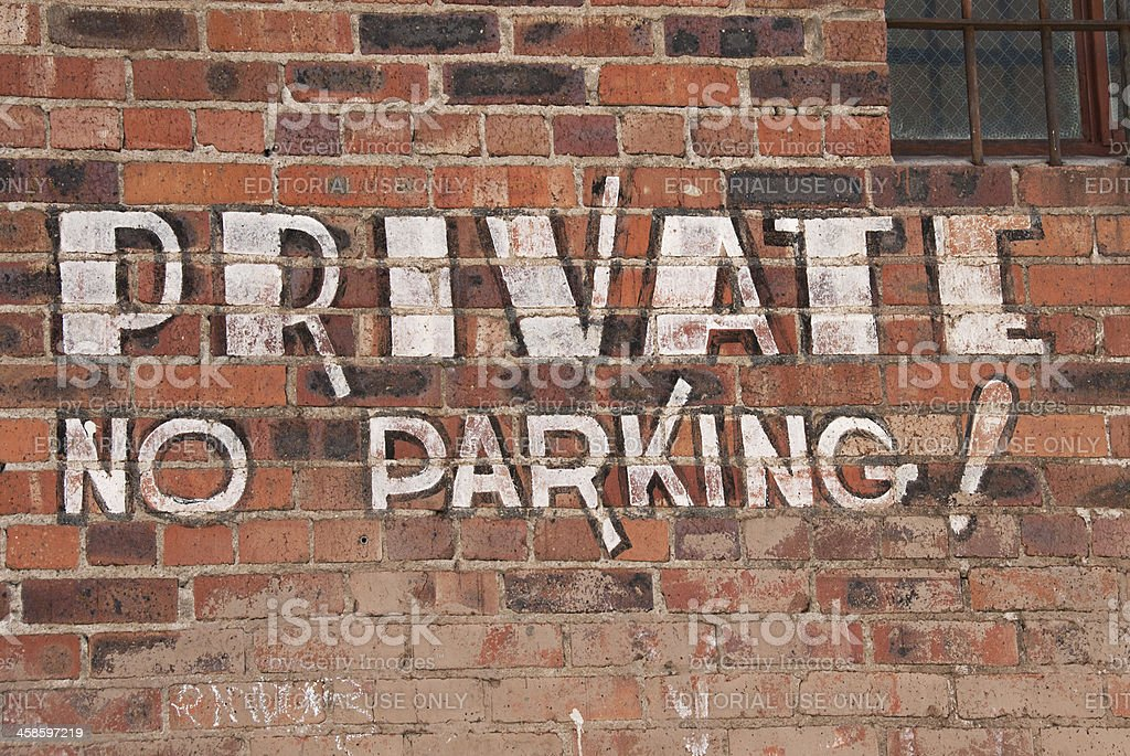PRIVATE, NO PARKING Calligraphy Style Mural, Commercial Building Brick Wall stock photo