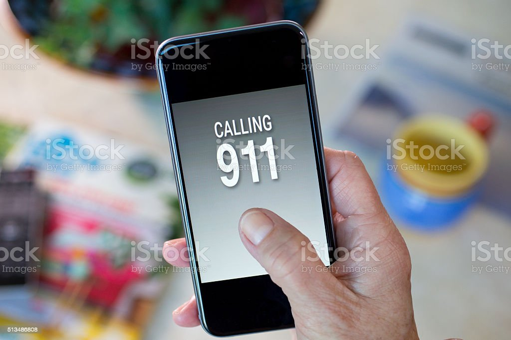 Calling 911 on a cell phone screen stock photo