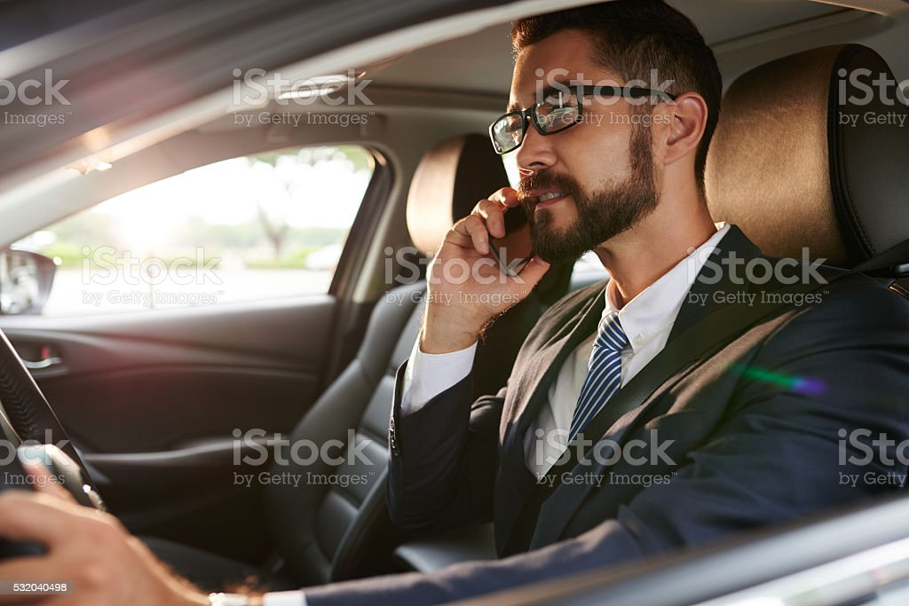 Calling and driving stock photo