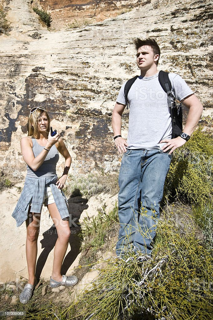 Calling for Assistance. Lost and Irritated Couple. Mountain Hiking Series. royalty-free stock photo