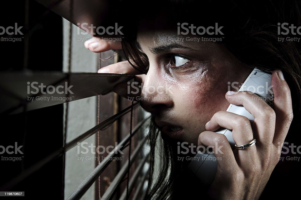 Calling for help; domestic abuse concept stock photo