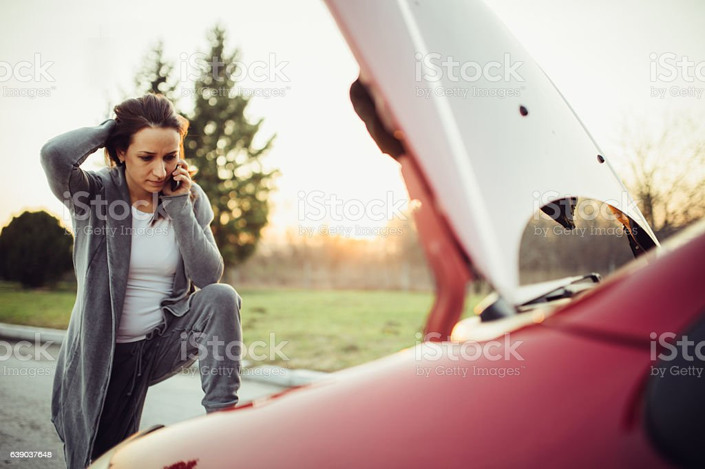 Calling for help on the road stock photo