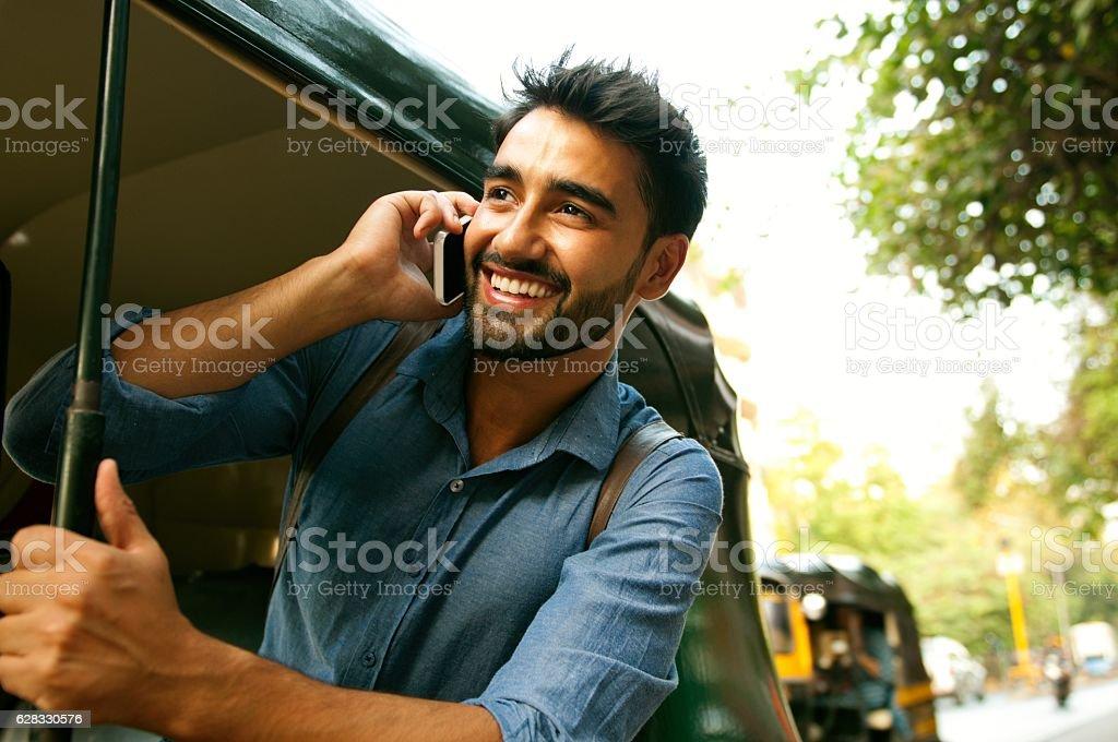 Calling from rickshaw. stock photo