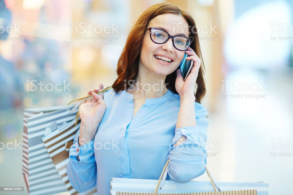Calling in the mall stock photo