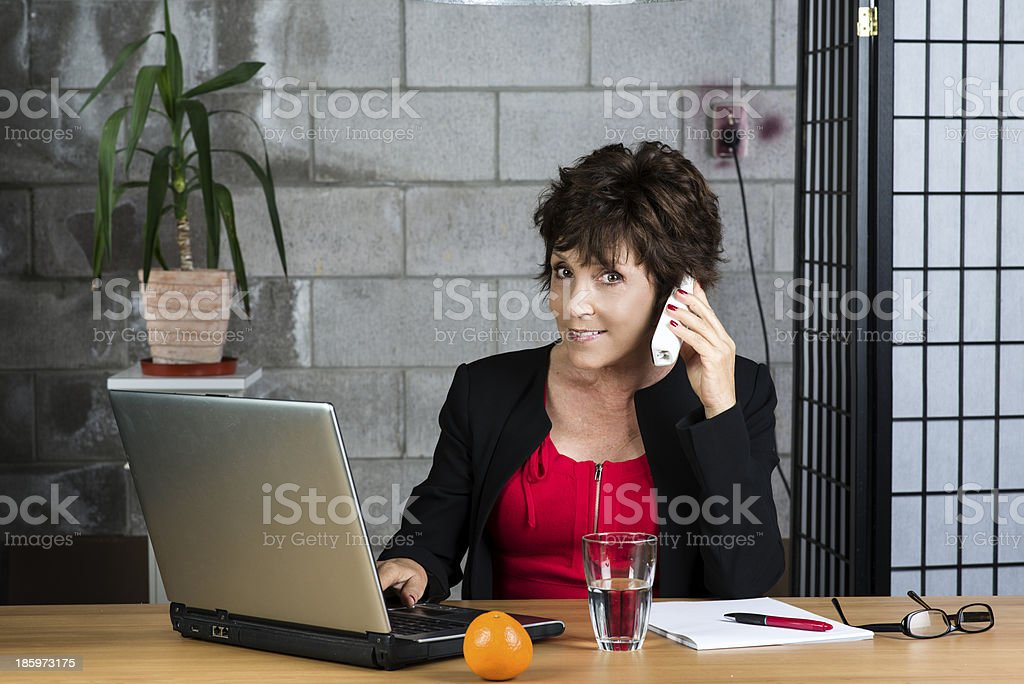 Calling mature businesswoman royalty-free stock photo
