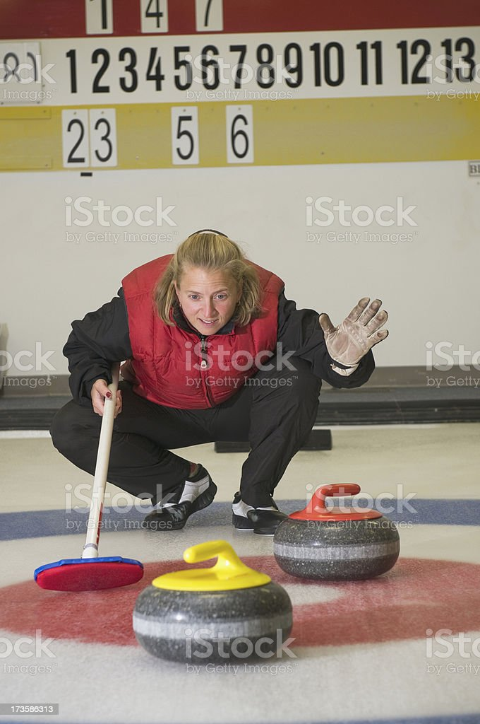 Calling the Shot in Curling Game stock photo