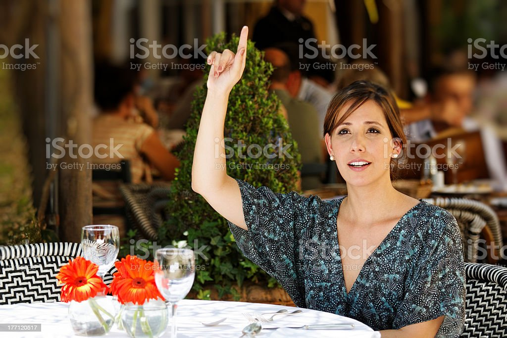Calling the waitress stock photo