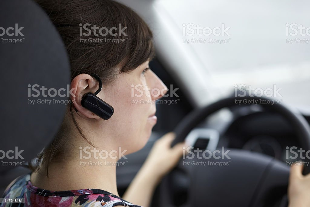calling with bluetooth headset and driving car stock photo